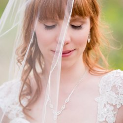 A beautiful bride up close with a veil over half of her face
