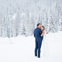A couple snuggled in during their winter wedding at Silver Star Mountain Resort