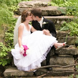 A couple kissing, sitting on a sock stair case