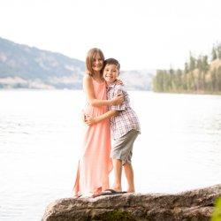 Siblings hugging on a rock on Kalamalka Lake