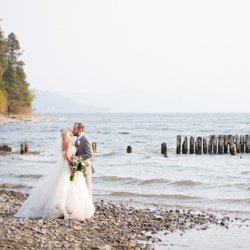 Bride and Groom standing on the lakeshore at Kopje Park