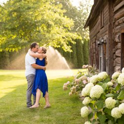A couple kissing at Brook and Barn in Kelowna