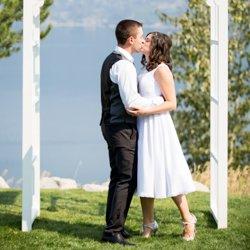 A couple kissing at the altar at La Casa Resort