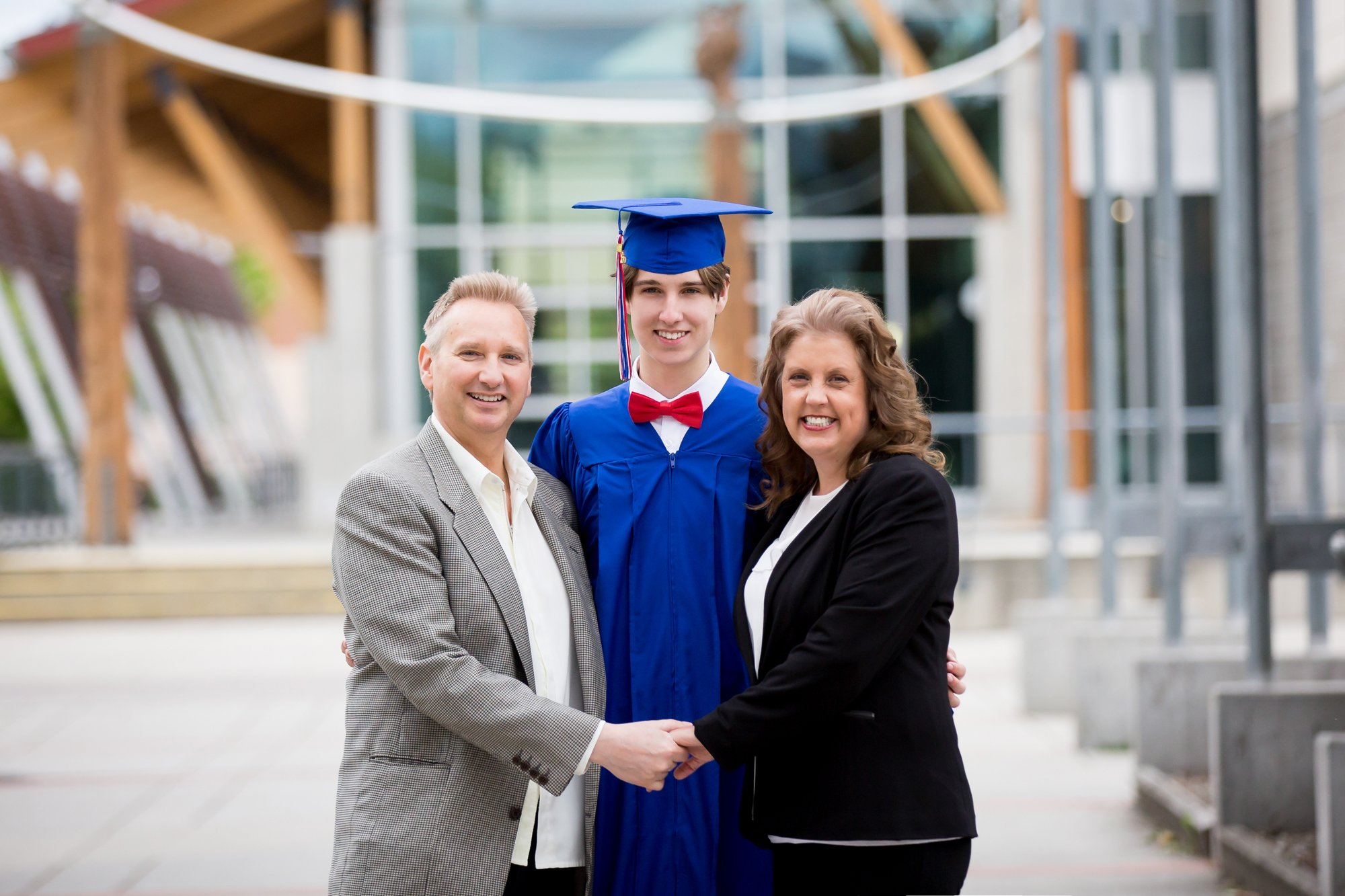 A grad with his parents